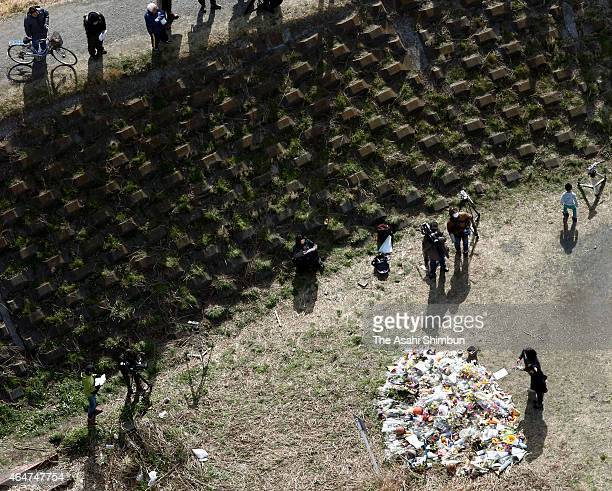 In this aerial image flowers and prayers are offered at a makeshift memorial where Ryota Uemura's body was found on February 28 2015 in Kawasaki...