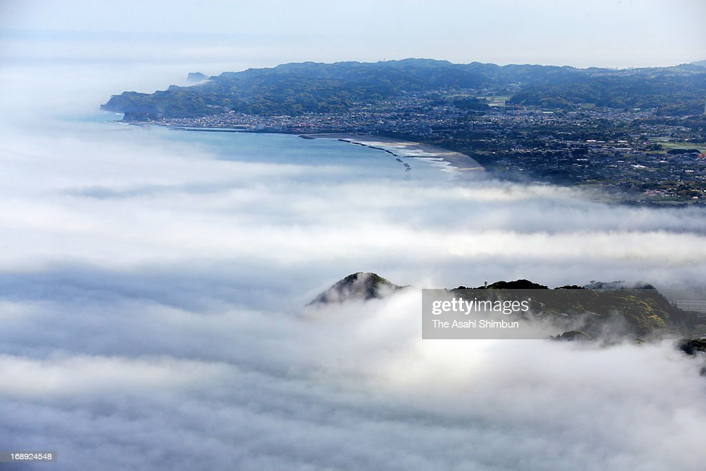In this aerial image, fog covered the coastline of Kujujurihama, typical phenomenon before the rainy season on May 15, 2013 in Isumi, Chiba, Japan.
