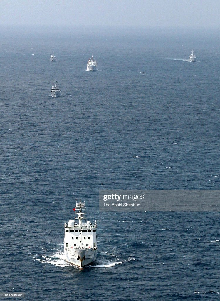 In this aerial image, four China Marine Surveillance ships sail along with Japan Coast Guard Patrol ship (top right) in the Japanese contiguous zone, 27-kilometer Southeast of Uotsuri Island, one of the disputed Senkaku Islands on October 24, 2012 in Ishigaki, Okinawa, Japan. Chinese ships appears the zone almost everyday since Japanese government purchased the islets.