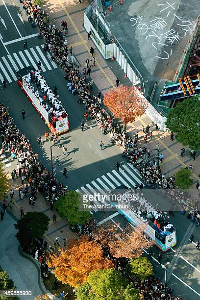 In this aerial image Fukuoka SoftBank Hawks players celebrate with fans during the victory parade on November 24 2014 in Fukuoka Japan 350000 fans...