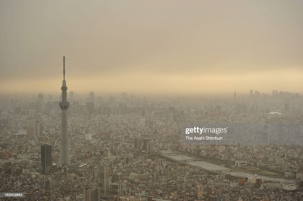 In this aerial image, haze covered Tokyo is seen on March 10, 2013 in Tokyo, Japan. Strong Northern wild by the cold front blow up dust and cover Japan's capital.