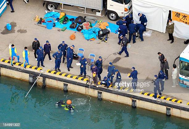 In this aerial image Hyogo Prefecture Police divers investigate to find a drum stuffed the body of the abondoned 51yearold missing man at Hinase Port...