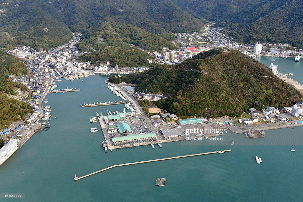 In this aerial image Hyogo Prefecture Police investigate to find a drum stuffed the body of the abondoned 51yearold missing man at Hinase Port on...
