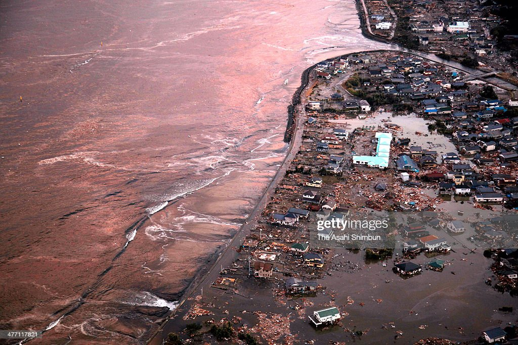In this aerial image Iwaki city which is devastated by the tsunami triggered by the magnitude 90 strong earthquake is seen on March 11 2011 in Iwaki...