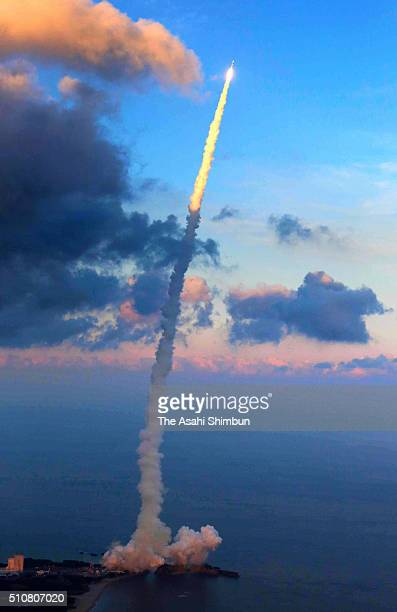 In this aerial image Japan Aerospace Exploration Agency HIIA 30 lifts off from the launch pad at the JAXA's Tanegashima Space Center on February 17...