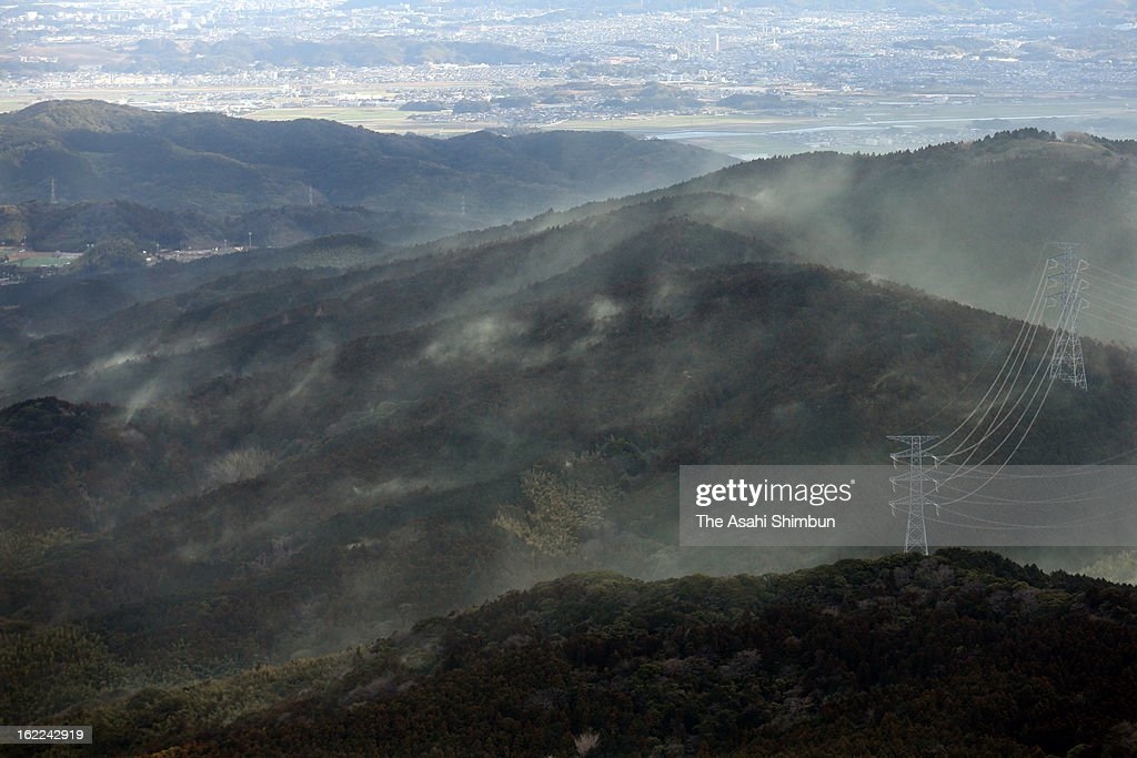 In this aerial image, Japanese cedar pollen blown by northwest wind scatter, forming a yellowish cloud over the area on February 20, 2013 in Munakata, Fukuoka, Japan. The dispersion and hay fever season arrives in Japan.
