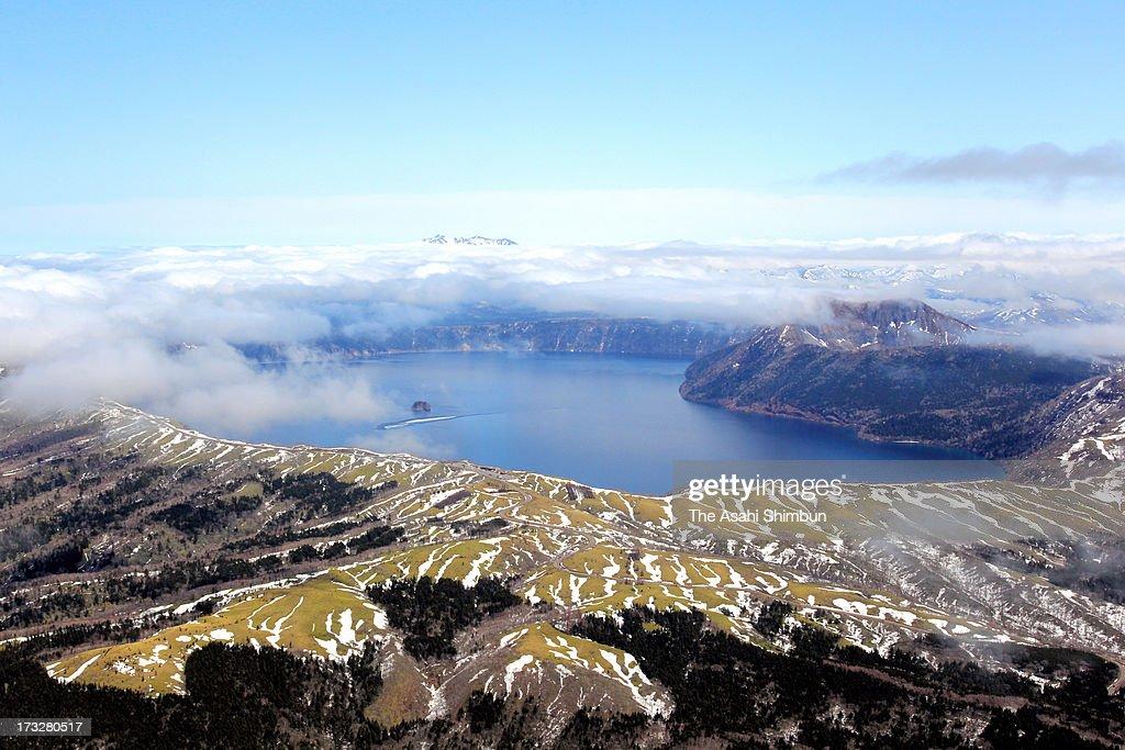 In this aerial image, Lake Mashu is seen on April 28, 2012 in Teshikaga, Hokkaido, Japan.