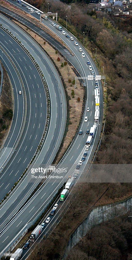 In this aerial image, long traffic jam turning off the Chuo Expressway at Otsuki junction, caused by nearby Sasago Tunnel collapse on December 2 which left nine people dead, on December 8, 2012 in Otsuki, Yamanashi, Japan.