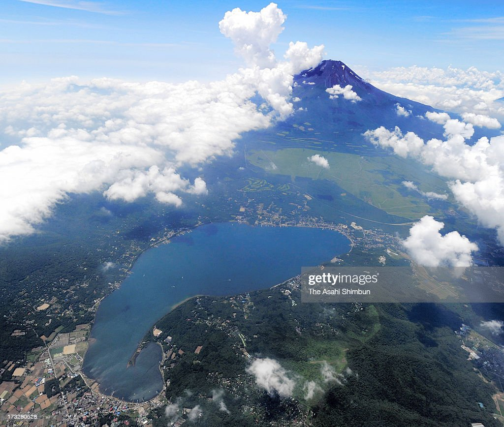 In this aerial image, Mount Fuji and Lake Yamanaka are seen on July 27, 2012 in Yamanakako, Yamanashi, Japan.