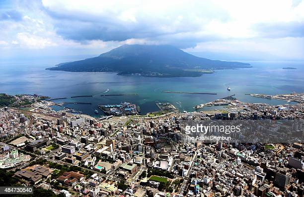 In this aerial image Mount Sakurajima and Kagoshima City are seen on August 21 2015 in Kagoshima Japan Eruptions have occurred 672 times between...