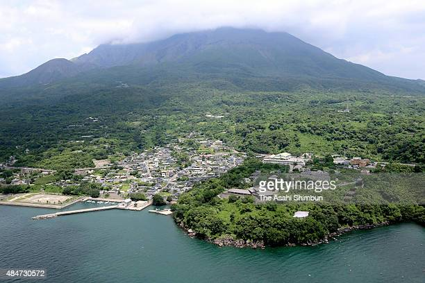 In this aerial image Mount Sakurajima is covered with clouds while Higashisakurajima area where an evecuation center is located is seen on August 21...