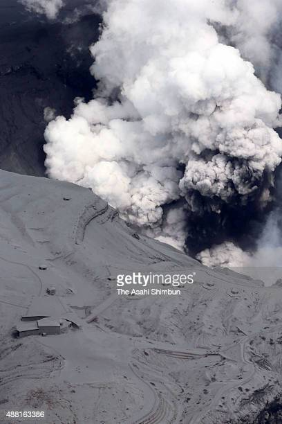 In this aerial image Mt Aso is seen spewing ashes on September 14 2015 in Aso Japan Mt Aso located in Japan's southwestern island of Kyushu erupted...