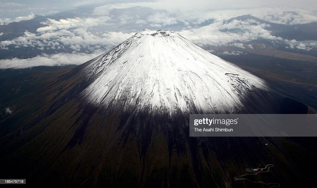 In this aerial image, Mt. Fuji is covered with the first snow of the season on October 19, 2013 in Fujiyoshida, Yamanashi, Japan.