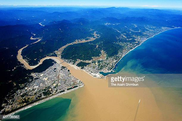 In this aerial image muddy water flows from Kumanogawa River afterthe heavy rain triggered by Typhoon Talas on September 7 2011 in Shingu Wakayama...