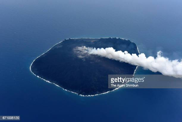 In this aerial image Nishinoshima Island erupts on April 21 2017 in Ogasawara Tokyo Japan A volcanic bomb shots up about 100 metres into the sky and...