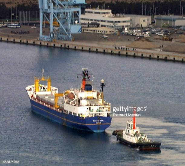 In this aerial image nuclear transport ship Pacific Teal is seen on arrival at Mutsu Ogawara Port while antinuclear protesters hold a rally on March...