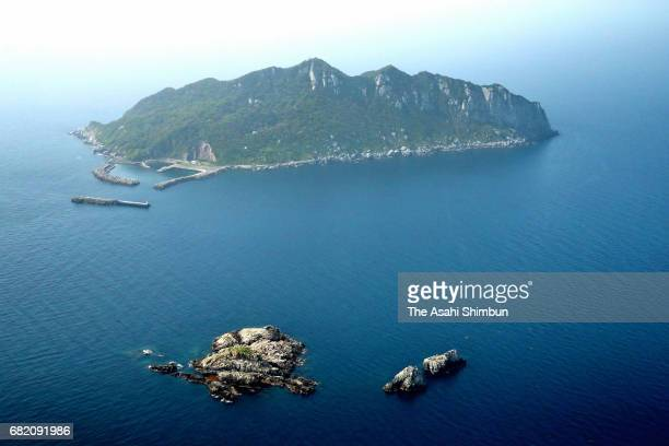 In this aerial image Okinoshima Island is seen on May 6 2017 in Munakata Fukuoka Japan A remote island in southwestern Japan that is deemed so sacred...