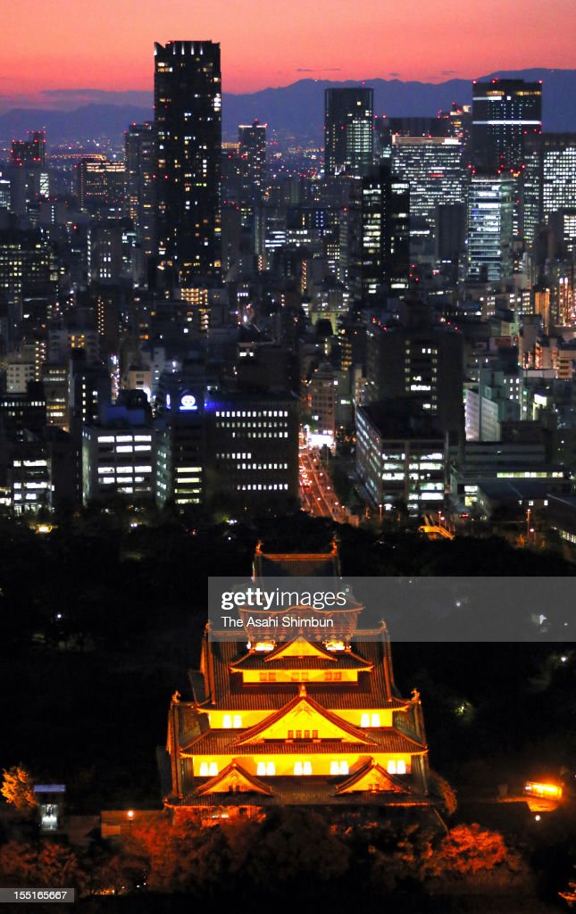 In this aerial image, Osaka Castle is illuminated as the Child Abuse Prevention campaign month begins on November 1, 2012 in Osaka, Japan.