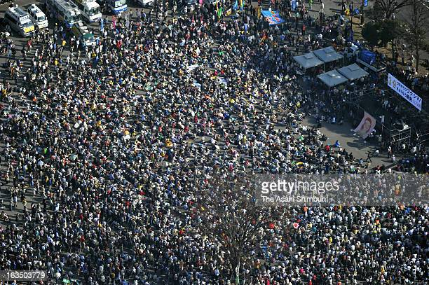 In this aerial image participants of an antinuclear protest gather at Meiji Park on March 9 2013 in Tokyo Japan On March 11 Japan is to commemorate...