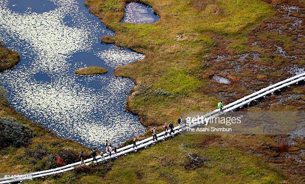 In this aerial image people enjoy trekking in the Ozegahara on October 2 2016 in Katashina Gunma Japan