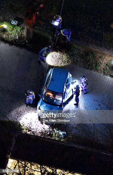 In this aerial image police officers investigate a car hit and killed two people on a sidewalk near the National Hospital Organization Disaster...
