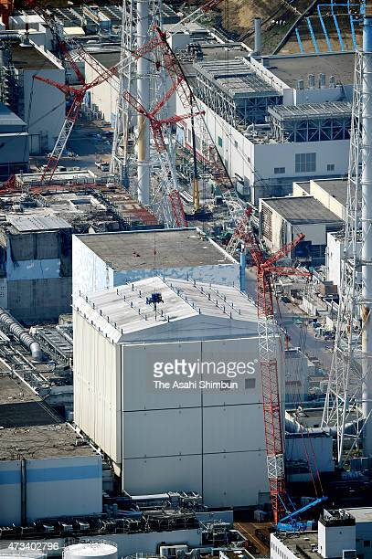 In this aerial image preparatory work to remove the cover around the No 1 reactor building starts at Tokyo Electric Power Co's Fukushima Daiichi...