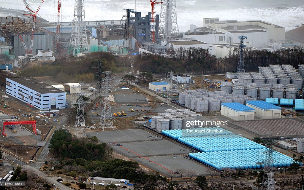 In this aerial image, radiation contaiminated water storage tanks are seen at crippled Fukushima Daiichi Nuclear Power Plant on April 7, 2013 in Okuma, Fukushima, Japan. The operator Tokyo Electric Power Co (TEPCO) confirmed the leakage of 710 billion becquerels of radioactivity from the storage tank, that is third from bottom covered with gray sheet