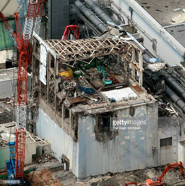 In this aerial image reactor decommissioning work continues on the exposed fifth floor of fourth reactor building at Fukushima Daiichi Nuclear Power...