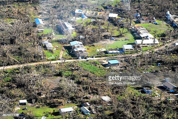 In this aerial image residential area devastated by Cyclone Pam is seen on March 20 2015 in Tanna Vanuatu The Category 5 storm hit late night on...
