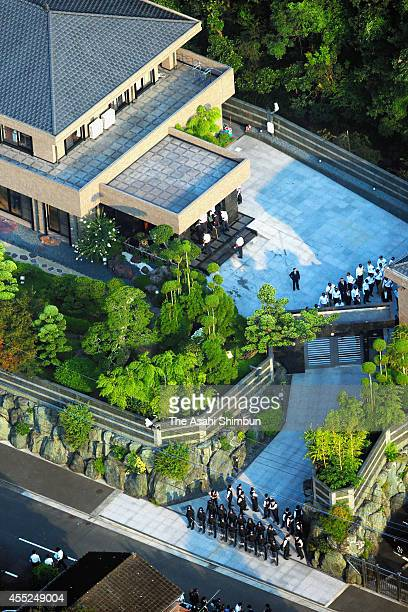 In this aerial image riot police stand guard at the gate of the house of Kudokai leader Satoru Nomura during the raid on September 11 2014 in...