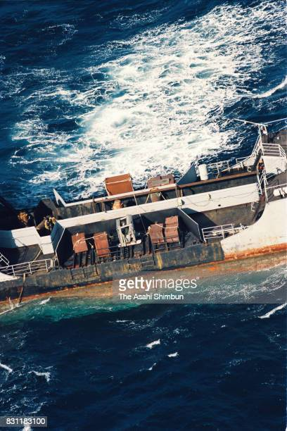 In this aerial image Russian Navy vessel TNT27 cruises as it disposes radioactive waste into the ocean while environment activist group Greenpeace...