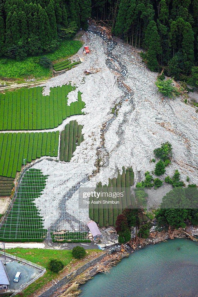 In this aerial image, sand and rocks destroy the tea plantation, due to the landslide triggered by the continuous heavy rain on July 19, 2012 in Yame, Fukuoka, Japan.