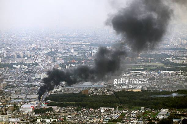 In this aerial image smoke billows from a Tokyo Electric Power Co facility on October 12 2016 in Niiza Saitama Japan A fire caused a blackout in the...