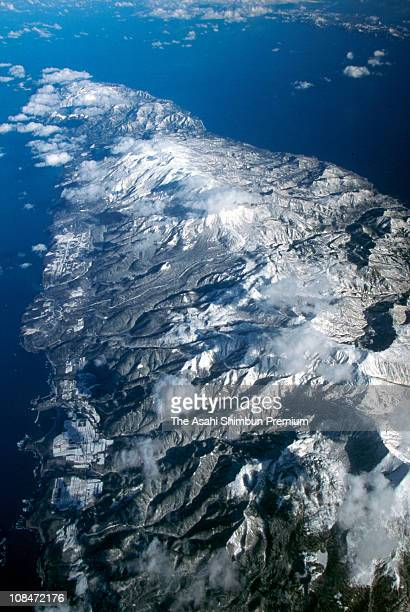 In this aerial image snowcovered Shiretoko Peninsula is seen on November 21 1998 in Shari Hokkaido Japan