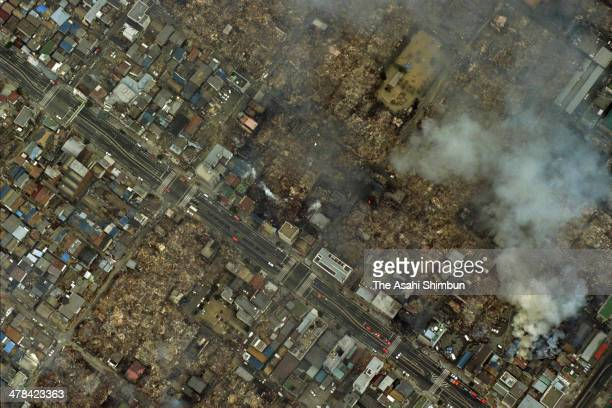 In this aerial image Suma area of Kobe is seen after fire triggered by the strong earthquake struck on Janaury 18 1995 in Kobe Hyogo Japan Magnitude...