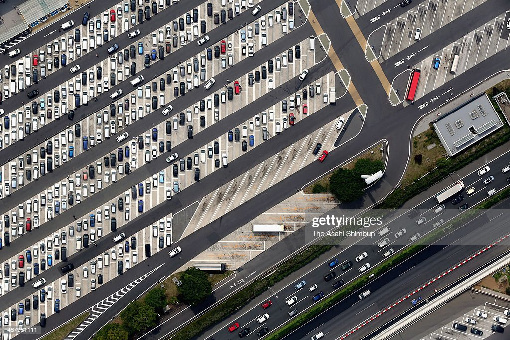 In this aerial image, the car park of the Tomei Expressway Ebina Service Area is nearly full on May 3, 2014 in Ebina, Kanagawa, Japan. Holiday goers transport peaks on the first day of three days weekend, part of the holiday season of the 'Golden Week' which began on April 29.