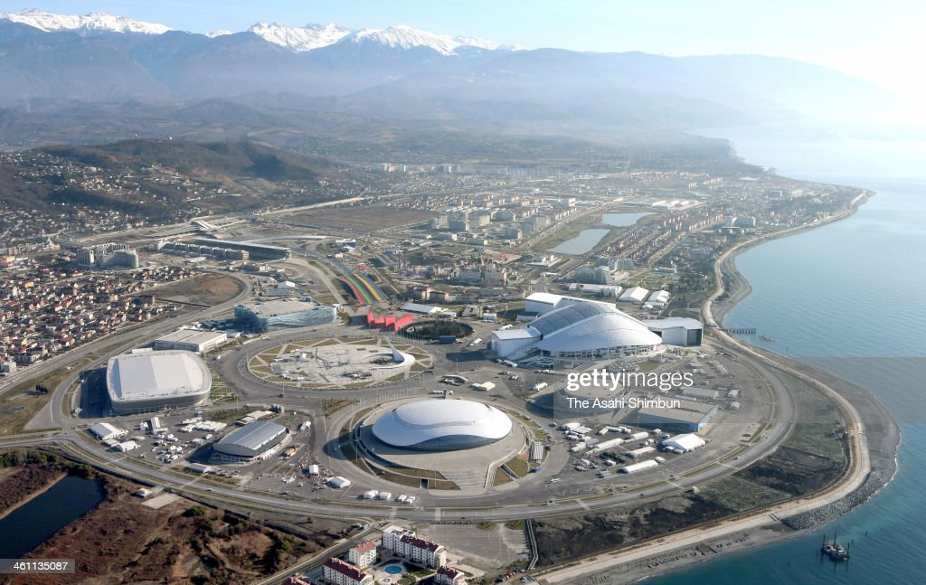 In this aerial image, the Coastal Cluster venues for the 2014 Winter Olympic Games are seen on January 4, 2014 in Sochi, Russia. The mountains in the back are Caucasus Mountains, and the border of Georgia is only 4km away.