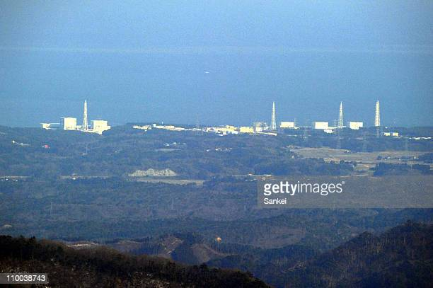 In this aerial image the damaged Fukushima Daiichi Nuclear Power Plant remains a threat after a powerful tsunami triggered by a 90 magnitude...