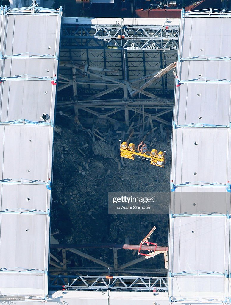 In this aerial image the damaged interior of the No 1 reactor building of the Fukushima Daiichi Nuclear Power Plant can be seen with two of the six...