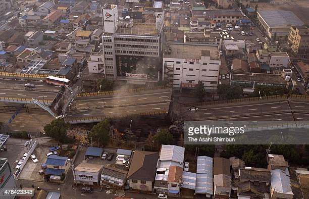 In this aerial image the elevated Hanshin Expressway collapses after the strong earthquake on January 17 1995 in Nishinomiya Hyogo Japan Magnitude 73...