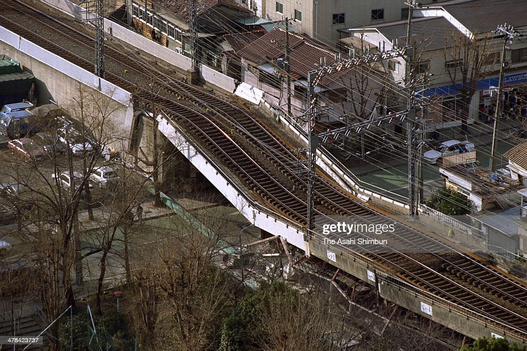 In this aerial image the elevated railway of the Hanshin Railway collapses after the strong earthquake on January 17 1995 in Kobe Hyogo Japan...
