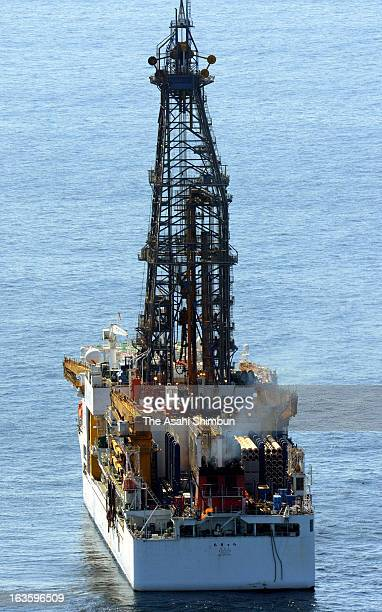 In this aerial image the first ever methane hydrate gas taken from seabed layers is seen lit at the stern of drilling vessel Chikyu as Japan Oil Gas...