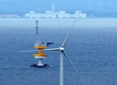 In this aerial image the Fukushima Mirai wind turbine floats 20 kilometers off the coast of Fukushima Prefecture the crippled Fukushima Daiichi...