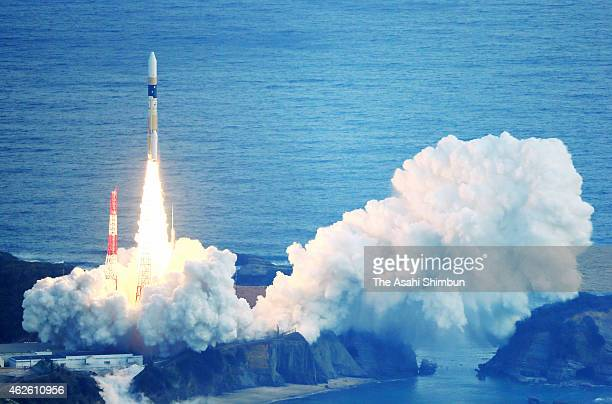 In this aerial image the H2A Launch Vehicle No 27 of the Japan Aerospace Exploration Agency lifts off from the Tanegashima Space Center on February 1...