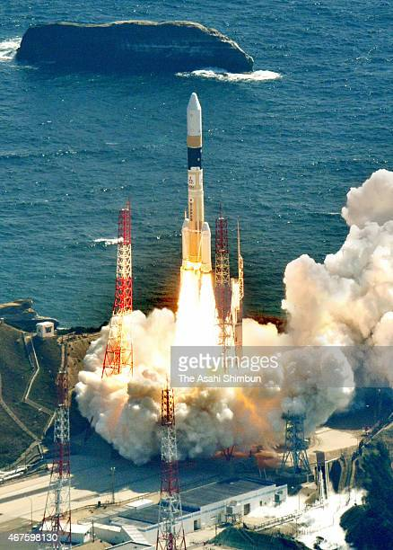 In this aerial image the H2A Launch Vehicle No 28 of the Japan Aerospace Exploration Agency lifts off from the launch pad at JAXA's Tanegashima Space...