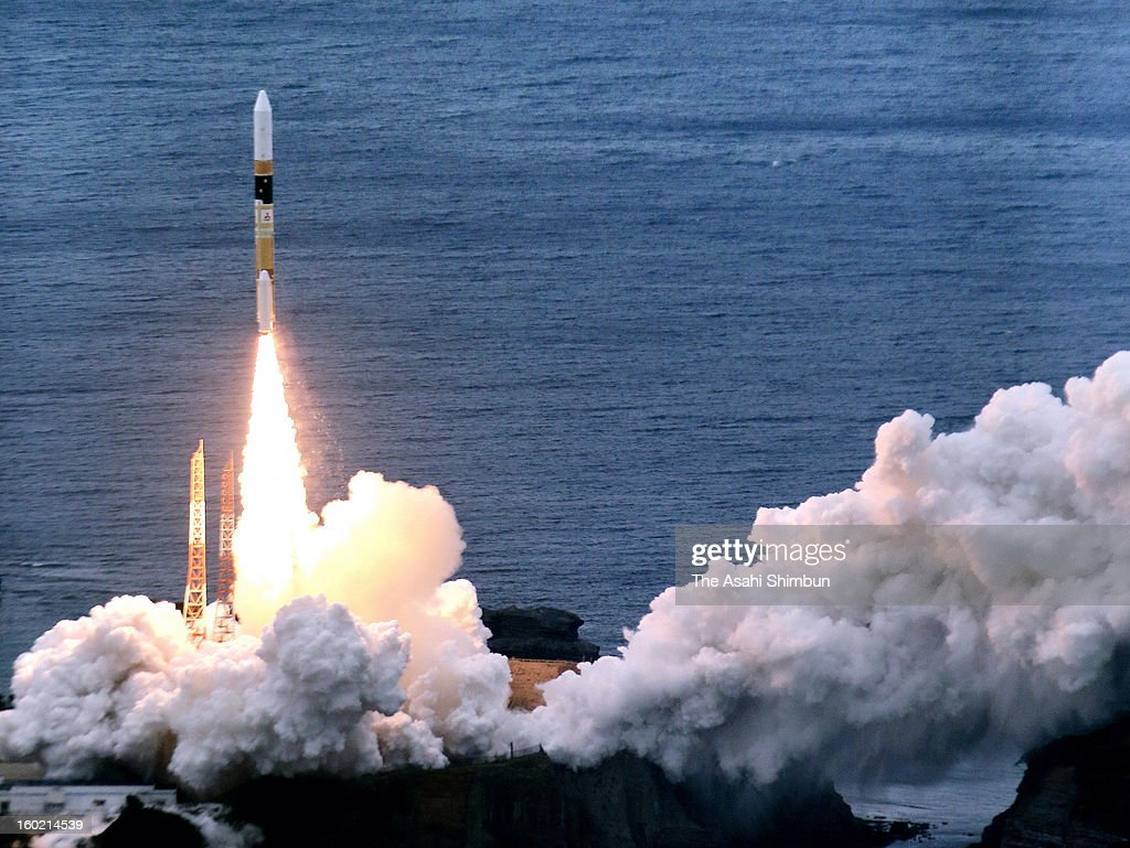 In this aerial image, the H2A-22 rocket, developed by The Japan Aerospace Exploration Agency (JAXA) and Mitsubishi Heavy Industries Ltd. lifts off from the launch pad at JAXA's Tanegashima Space Center on January 27, 2013 in Minamitane, Japan. The rocket carries information-gathering radar satellite and optical satellite.