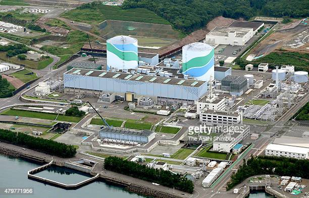 In this aerial image the Kyushu Electric Power Co's Sendai nuclear power plant as the utility begins moving nuclear fuel into a reactor on July 7...