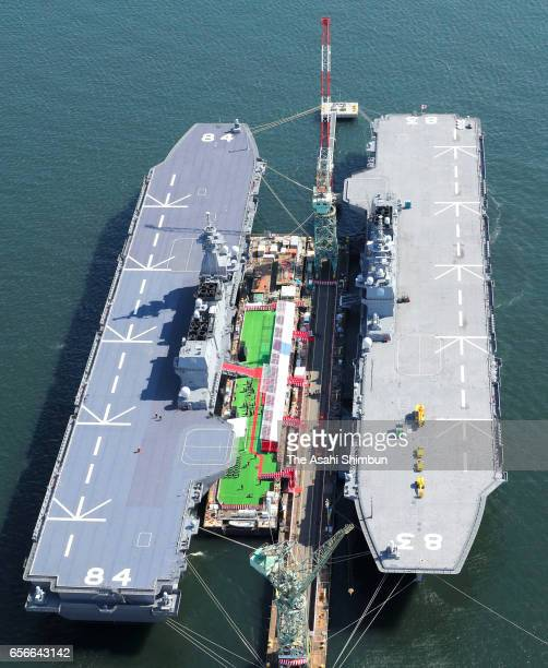 In this aerial image the Maritime SelfDefense Force's new destroyer Kaga is commissioned along with 'Izumo' on March 22 2017 in Yokohama Japan The...
