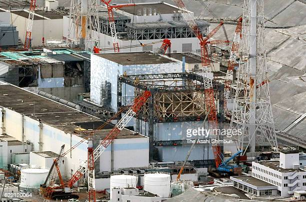 In this aerial image the No 1 reactor building at the crippled Fukushima Daiichi Nuclear Power Plant is completely exposed after the last of 18...