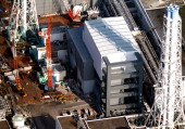 In this aerial image The No 4 reactor building of the Tokyo Electric Power Co 's Fukushima Daiichi Nuclear Power Plant is seen on November 18 2013 in...